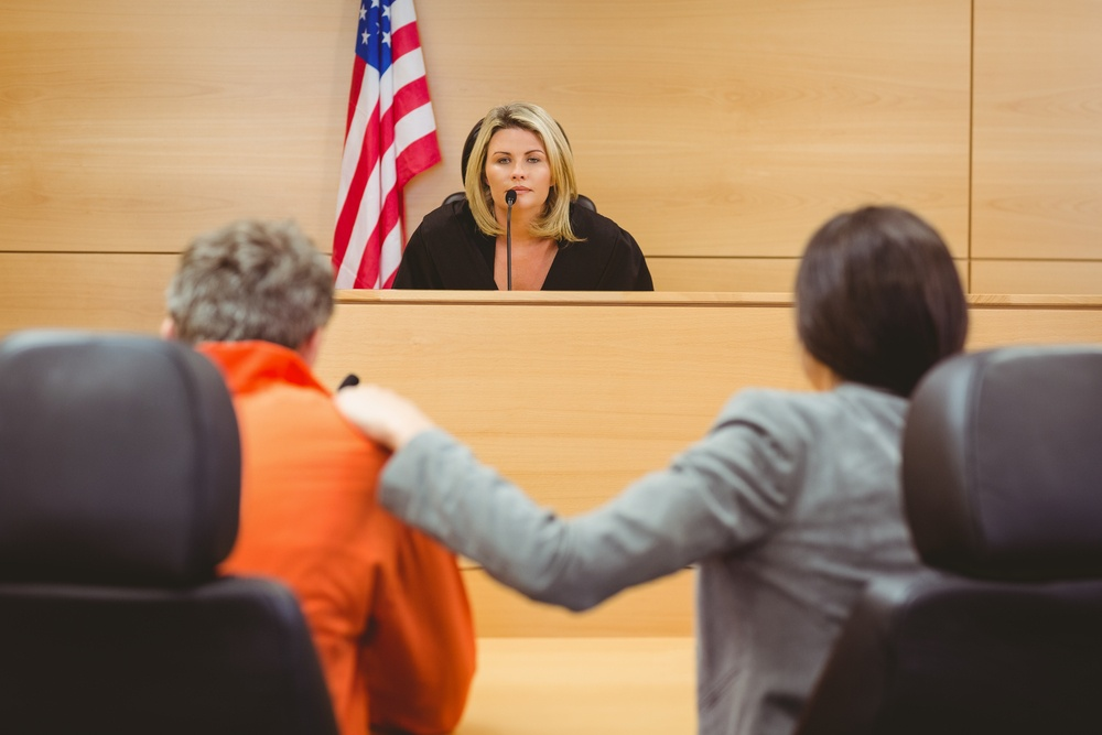 Judge and lawyer discussing the sentence for prisoner in the court room.jpeg
